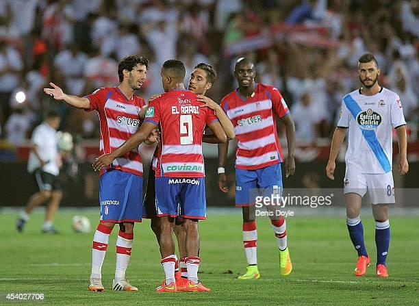 Diego Mainz of Granada CF celebrates with Youssef El Arabi of Granada CF after they beat RC Deportivo La Coruna 21 in the La liga match between...