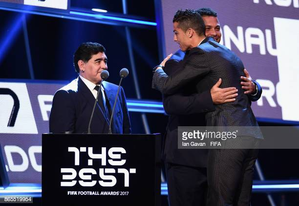 Diego Maradona and Ronaldo congratulates Cristiano Ronaldo as he is awarded The Best FIFA Men's Player during The Best FIFA Football Awards at The...
