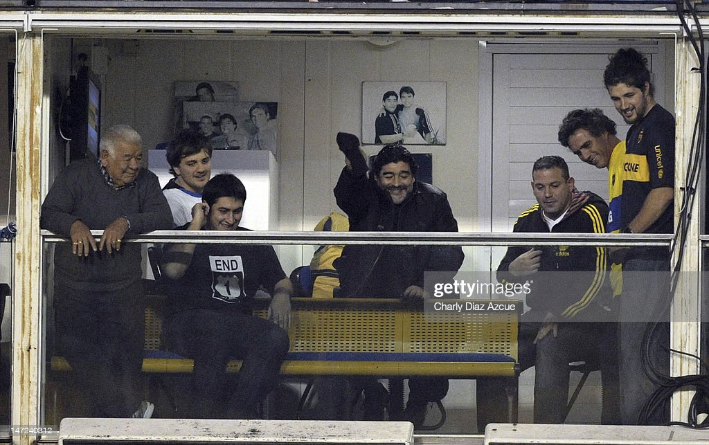 Diego Maradona cheers before a match between Boca Juniors and Corinthians as part of the first leg of the Libertadores Cup 2012 finals at Bombonera Stadium on June 27, 2012 in Buenos Aires, Argentina.