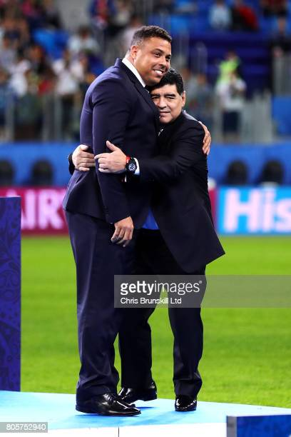 Diego Maradona embraces Ronaldo following the FIFA Confederations Cup Russia 2017 Final match between Chile and Germany at Saint Petersburg Stadium...