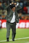 Diego Maradona head coach of Argentina celebrates a goal during the 2010 FIFA World Cup South Africa Group B match between Greece and Argentina at...