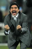 Diego Maradona head coach of Argentina celebrates after Gonzalo Higuain scores his side's second goal during the 2010 FIFA World Cup South Africa...