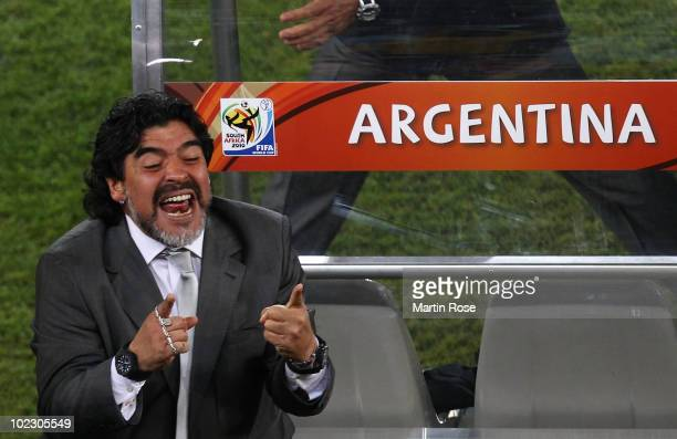 Diego Maradona head coach of Argentina celebrates victory after the 2010 FIFA World Cup South Africa Group B match between Greece and Argentina at...