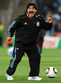 Diego Maradona head coach of Argentina controls the ball during the warm up ahead of the 2010 FIFA World Cup South Africa Round of Sixteen match...