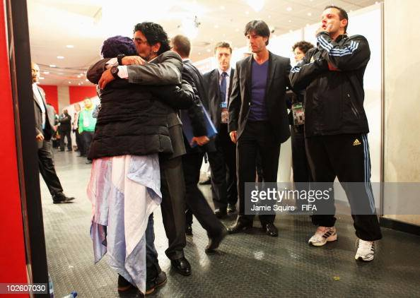 Diego Maradona head coach of Argentina embraces his daughter Dalma as Joachim Loew head coach of Germany looks on after the 2010 FIFA World Cup South...