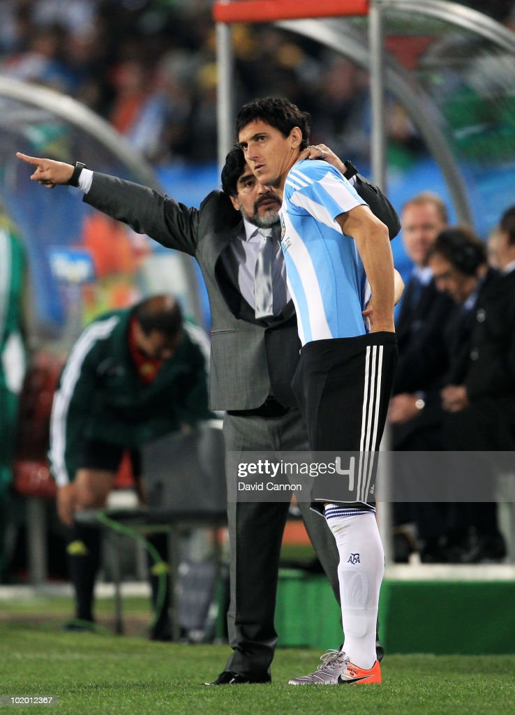 Diego Maradona head coach of Argentina gives final instructions to Nicolas Burdisso before he comes onto the pitch during the 2010 FIFA World Cup...