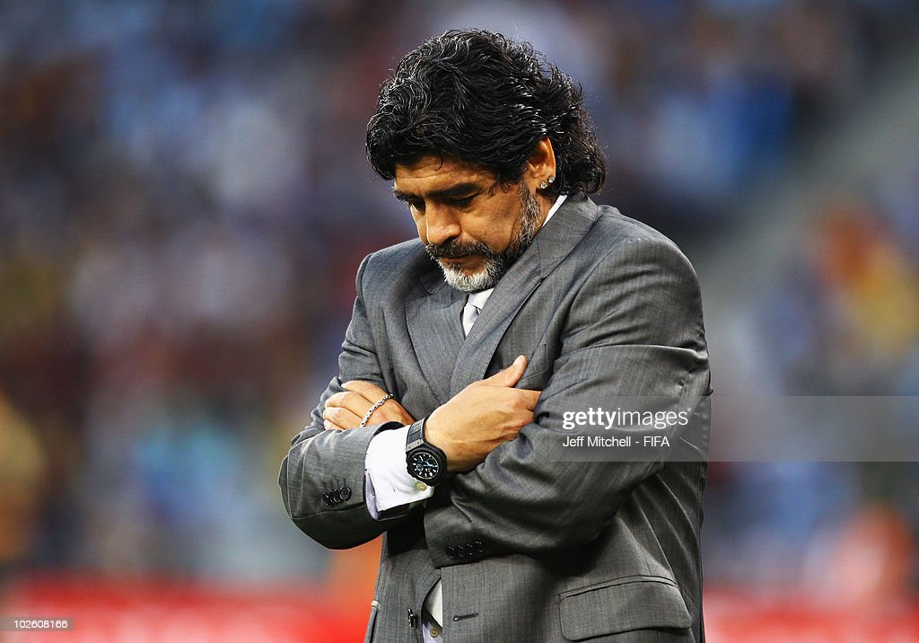Diego Maradona head coach of Argentina looks down with dejection during the 2010 FIFA World Cup South Africa Quarter Final match between Argentina and Germany at Green Point Stadium on July 3, 2010 in Cape Town, South Africa.