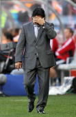Diego Maradona head coach of Argentina looks frustrated on the touchline during the 2010 FIFA World Cup South Africa Quarter Final match between...