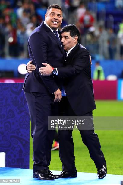 Diego Maradona kisses Ronaldo following the FIFA Confederations Cup Russia 2017 Final match between Chile and Germany at Saint Petersburg Stadium on...