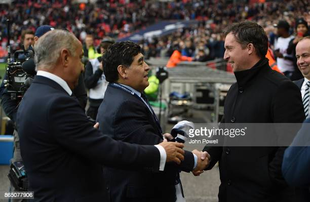 Diego Maradona legend of football and Ossie Ardiles legend of Tottenham Hotspur with Robbie Fowler legend of Liverpool during the Premier League...