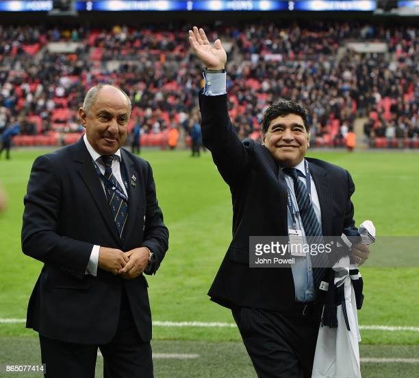 Diego Maradona legend of football with Ossie Ardiles legend of Tottenham Hotspur during the Premier League match between Tottenham Hotspur and...