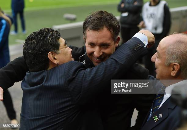 Diego Maradona legend of football with Robbie Fowler legend of Liverpool during the Premier League match between Tottenham Hotspur and Liverpool at...