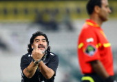 Diego Maradona manager of Al Wasl gestures during the Pro Etisalat League match between Al Wasl and Dubai Al Maktoum Stadium on January 05 2012 in...