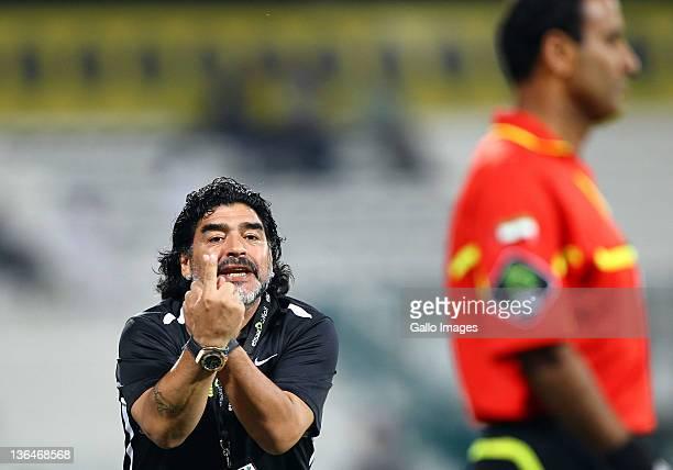 Diego Maradona manager of Al Wasl gestures during the Pro Etisalat League match between Al Wasl and Dubai Al Maktoum Stadium on January 05 2012 in...