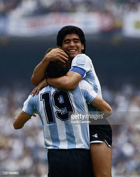 Diego Maradona of Argentina congratulates team mate Oscar Ruggeri after he scores the second goal against the Republic of Korea during the Group A...