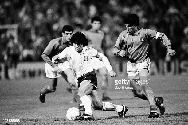 Diego Maradona of Argentina evades Salvatore Bagni of Italy both of whom play for Napoli during a FIFA Exhibition match held in Zurich on 10th June...