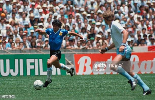 Diego Maradona of Argentina in action with the player of England during the World Cup quarter final match between Argentina and England on June 22...