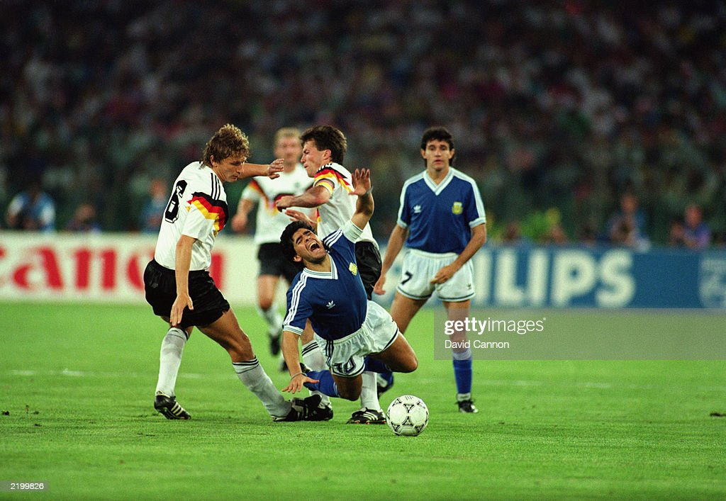 Diego Maradona of Argentina is brought down by both Guido Buchwald (left) and Lothar Matthaus (right) of West Germany during the FIFA World Cup Finals 1990 Final between West Germany and Argentina held on July 8, 1990 at the Stadio Olimpico, in Rome, Italy. West Germany won the match and final 1-0.