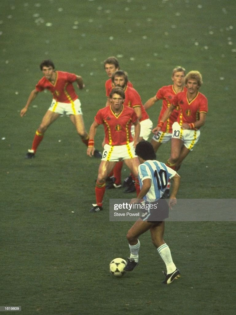 <a gi-track='captionPersonalityLinkClicked' href=/galleries/search?phrase=Diego+Maradona&family=editorial&specificpeople=210535 ng-click='$event.stopPropagation()'>Diego Maradona</a> of Argentina #10 is confronted by a posse of Belgium defenders during the match in the 1982 Wold Cup in Spain. \ Mandatory Credit: Steve Powell /Allsport