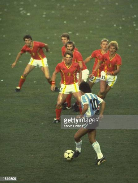 Diego Maradona of Argentina is confronted by a posse of Belgium defenders during the match in the 1982 Wold Cup in Spain Mandatory Credit Steve...