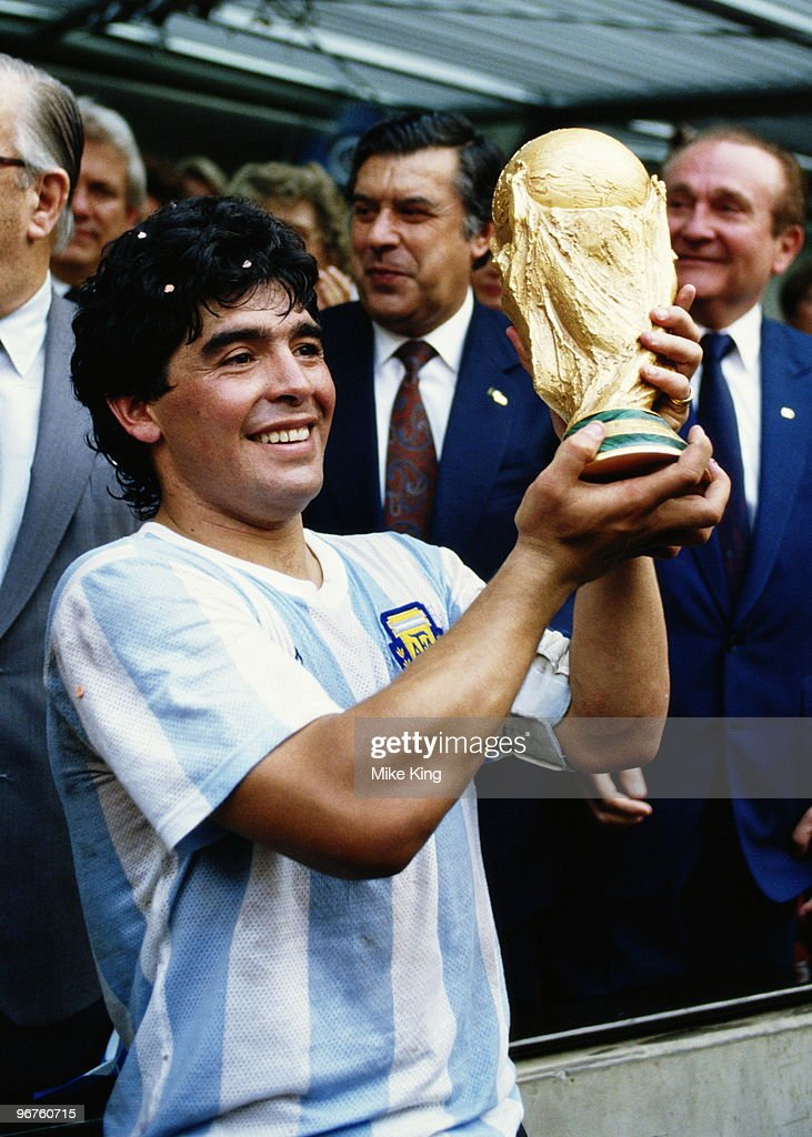 <a gi-track='captionPersonalityLinkClicked' href=/galleries/search?phrase=Diego+Maradona&family=editorial&specificpeople=210535 ng-click='$event.stopPropagation()'>Diego Maradona</a> of Argentina lifts the trophy and celebrates winning the FIFA World Cup final on 29 June 1986 against West Germany at the Azteca Stadium in Mexico City. Argentina won the match 3-2.