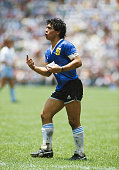 Diego Maradona of Argentina reacts whilst carrying a water bag during the FIFA 1986 World Cup match between Argentina and England at the Azteca...