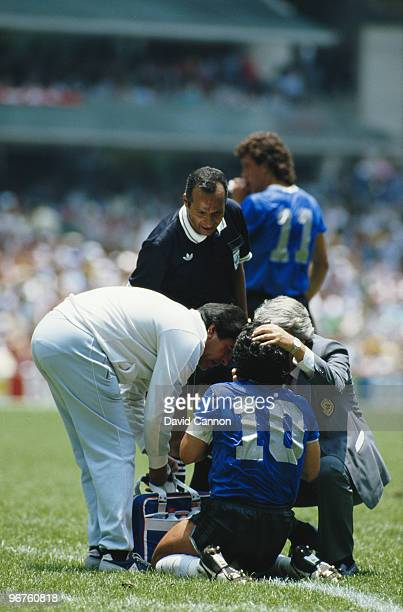 Diego Maradona of Argentina receives medical attention during the 1986 FIFA World Cup Quarter Final on 22 June 1986 at the Azteca Stadium in Mexico...