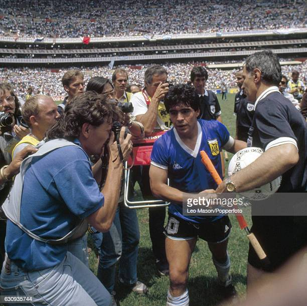 Diego Maradona of Argentina shakes hands with linesman Bogdan Dotchev who had been closest to the 'Hand of God' when Maradona scored the 1st goal...