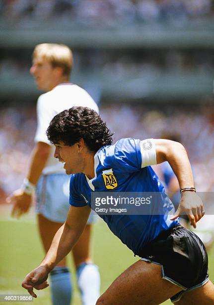 Diego Maradona of Argentina turns to celebrate after scoring the first goal as England defender Gary Stevens looks towards the linesman during the...