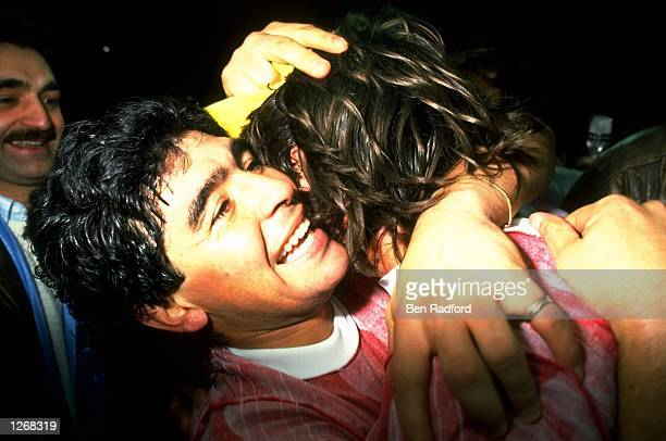 Diego Maradona of Napoli celebrates after the UEFA Cup SemiFinal Second Leg match against Bayern Munich in Naples Italy Napoli won 42 on aggregate...
