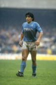 Diego Maradona of Napoli SSC rests during an Italian League match against AC Milan at the San Paolo Stadium in Naples Italy The match ended in a 00...