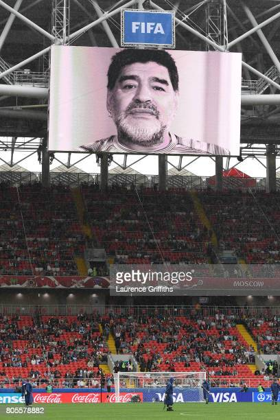 Diego Maradona reads a message on screen prior to the FIFA Confederations Cup Russia 2017 PlayOff for Third Place between Portugal and Mexico at...