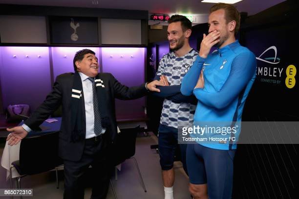 Diego Maradona speaks to Hugo Lloris of Tottenham Hotspur and Harry Kane of Tottenham Hotspur in the Tottenham Hotspur changing room prior to the...