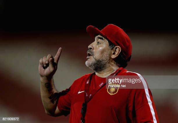 Diego Maradona the new head coach of Fujairah FC gestures to players during a training session at Fujairah Stadium on July 24 2017 in Fujairah United...