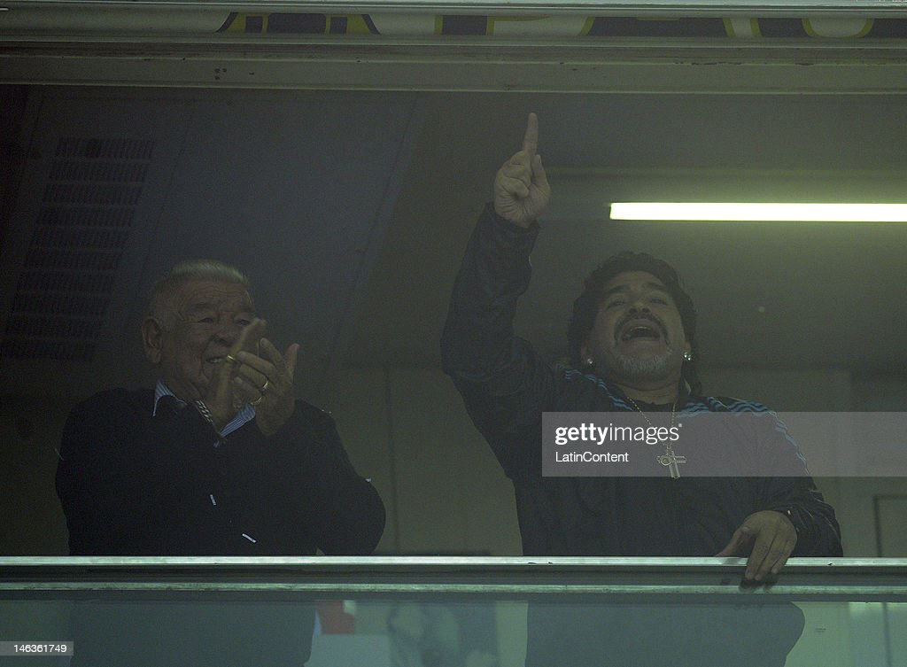 Diego Maradona with his father cheer for Boca during the first leg of the Copa Libertadores 2012 semi-finals between Boca Jrs and Universidad de Chile at Bombonera Stadium on June 14, 2012 in Buenos Aires, Argentina.