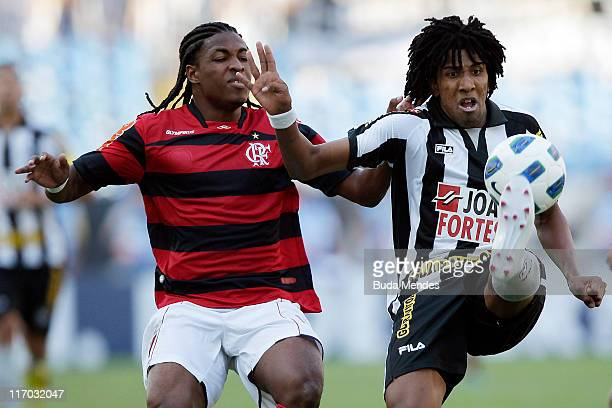 Diego Mauricio of Flamengo struggles for the ball with Bruno Cortez of Botafogo during a match as part of Brazilian Championship Serie A at Engenhao...