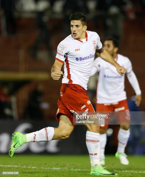Diego Mendoza of Huracan celebrates after scoring the opening goal during a second leg match between Huracan and Deportivo Anzoategui as part of...
