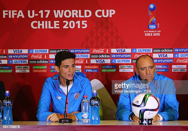 Diego Mesen of Costa Rica speaks during a press conference as head coach Marcelo Herrera of Costa Rica looks on at Estadio Chinquihue on October 24...