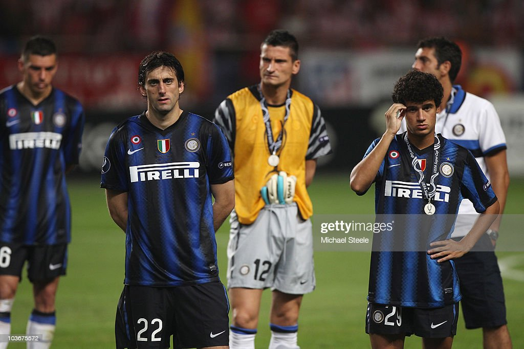 Diego Milito (centre L) and Coutinho (R) and Inter Milan team-mates stand dejected after their team's 0-2 defeat at the end of the UEFA Super Cup match between Inter Milan and Atletico Madrid at Louis II Stadium on August 27, 2010 in Monaco, Monaco.