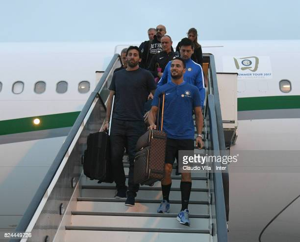 Diego Milito and Danilo D'Ambrosio of FC Internazionale arrive at Malpensa Airport on July 30 2017 in Milan