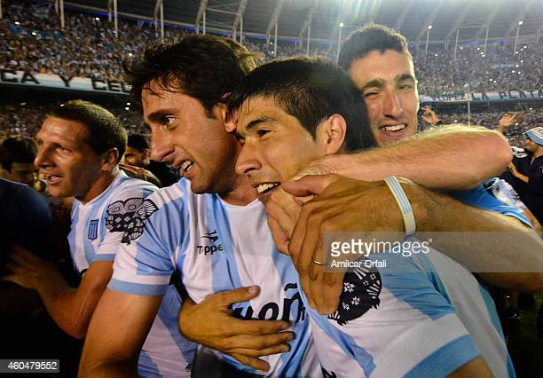 Diego Milito and Leandro Grimi of Racing Club celebrate the championship after winning a match between Racing Club and Godoy Cruz as part of 19th...