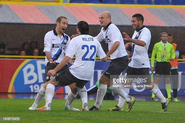 Diego Milito of FC Internazionale celebrates with his teammates after scoring their second goal during the Serie A match between Bologna FC and FC...