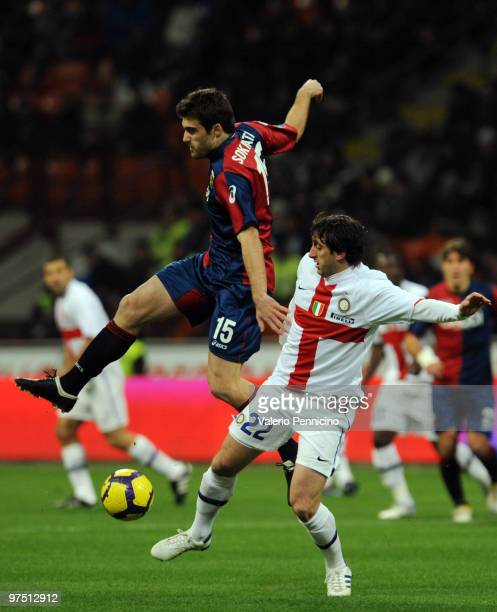 Diego Milito of FC Internazionale Milano battles for the ball with Sokratis Papastathopoulos of Genoa CFC during the Serie A match between FC...