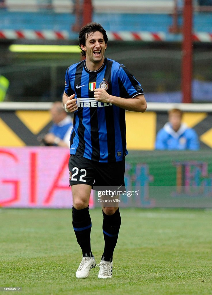 <a gi-track='captionPersonalityLinkClicked' href=/galleries/search?phrase=Diego+Milito&family=editorial&specificpeople=689963 ng-click='$event.stopPropagation()'>Diego Milito</a> of FC Internazionale Milano celebrates after scoring his team's third goal during the Serie A match between FC Internazionale Milano and AC Chievo Verona at Stadio Giuseppe Meazza on May 9, 2010 in Milan, Italy.
