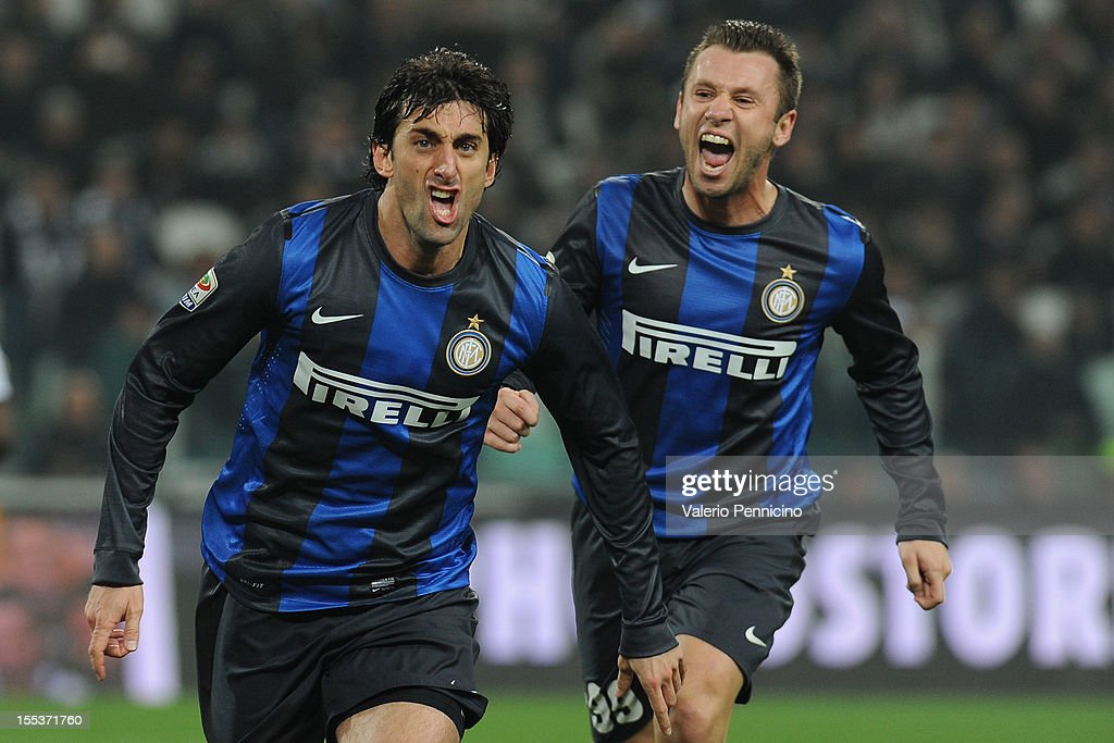 <a gi-track='captionPersonalityLinkClicked' href=/galleries/search?phrase=Diego+Milito&family=editorial&specificpeople=689963 ng-click='$event.stopPropagation()'>Diego Milito</a> (L) of FC Internazionale Milano celebrates his goal during the Serie A match between Juventus FC and FC Internazionale Milano at Juventus Arena on November 3, 2012 in Turin, Italy.