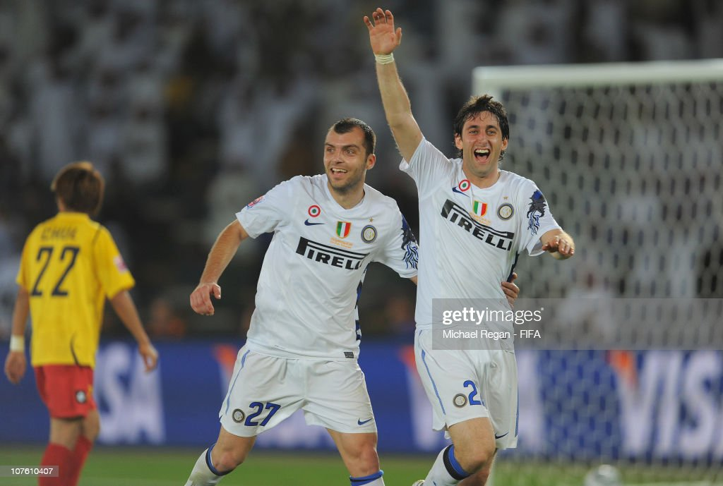 Diego Milito of FC Internazionale Milano celebrates scoring to make it 3-0 with Goran Pandev during the FIFA Club World Cup match between Seongnam Ilhwa Chunma FC and Inter Milan at Zayed Sports City on December 15, 2010 in Abu Dhabi, United Arab Emirates.