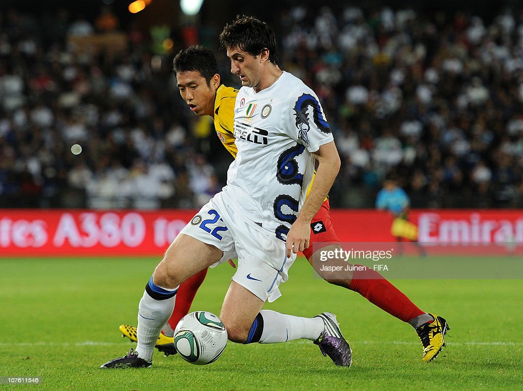 Diego Milito (R) of FC Internazionale Milano shields Cho Byung Kuk of Seongnam Ilhwa Chunma F.C. from the ball during the FIFA Club World Cup semi final match between Seongnam Ilhwa Chunma FC and Inter Milan at Zayed Sports City on December 15, 2010 in Abu Dhabi, United Arab Emirates.