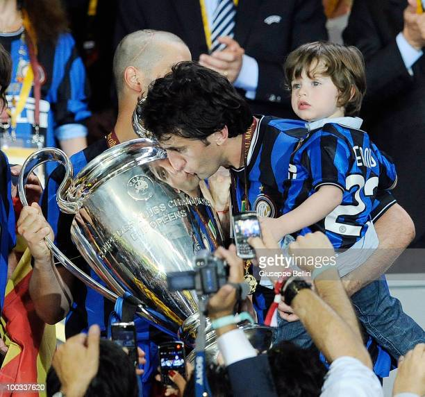 Diego Milito of Inter Milan kisses the UEFA Champions League trophy at the end of the UEFA Champions League Final match between FC Bayern Munich and...