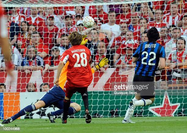 Diego Milito of Inter Milan scores the opening goal during the UEFA Champions League Final match between FC Bayern Muenchen and Inter Milan at...