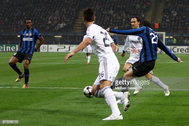 Diego Milito of Inter Milan scores the opening goal during the UEFA Champions League Round of 16 first leg match between Inter Milan and Chelsea at...
